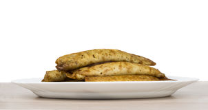 Pancake stuffed in white dish on wooden table Royalty Free Stock Image