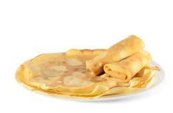 Pancake su una zolla bianca Immagine Stock