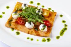Pancake with tomato and Arugula. With matsarella stock photo