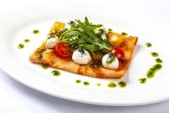 Pancake with tomato and Arugula. With matsarella royalty free stock photo