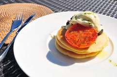 Pancake. With tomato and poached eggs Royalty Free Stock Photos