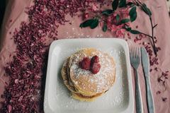 Pancake Topped With Strawberries and Dust of Powdered Sugar in White Square Ceramic Plate Royalty Free Stock Images