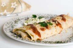 Pancake / tortilla / burrito on plate Royalty Free Stock Image