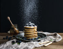 Pancake tower with fresh blueberry and mint on a rustic metal plate. Royalty Free Stock Image