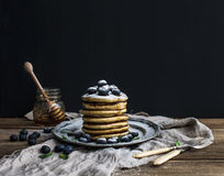 Pancake tower with fresh blueberry and mint on a rustic metal plate. Stock Photography