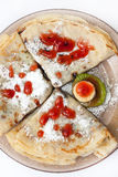 Pancake triangles with strawberry syrup and kiwi Royalty Free Stock Photography