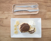 Pancake and vanilla ice cream with chocolate syrup topping Royalty Free Stock Image