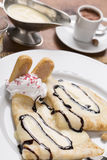 Pancake with vanilla puding on the plate, decorated with whipped Stock Image