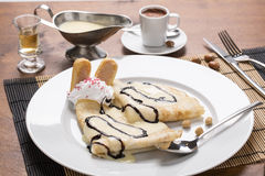 Pancake with vanilla puding on the plate, decorated with whipped Royalty Free Stock Images