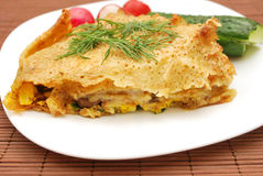 Pancake and vegetables. Pancake (with mushrooms and egg filling) and vegetables Royalty Free Stock Image