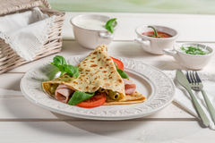 Pancake with vegetables and ham Stock Photos