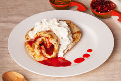 Pancake with whipped cream jam plate still life Stock Photo