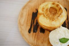 Pancake with whipped cream. And slice of pineapple on top Stock Photos