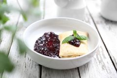 Pancake with white cheese and fruit marmalade. Appetite dish. Homemade sweet pancakes, served with cheese stuffing and sweet fruit jam royalty free stock images