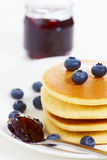 Pancake on white with jam a Royalty Free Stock Images