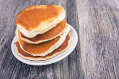 Pancake on wooden table Stock Images