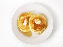 Pancakes 1 (paths included). Silver Dollar Pancakes with butter and syrup on white plate, with fork and knife, isolated on white background. Two paths included royalty free stock photography