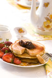 Pancakes. With strawberry and sour cherries jam Stock Photo