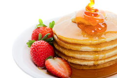 Pancakes. And strawberry with maple syrup poured on top