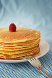 Pancakes. Stack of pancakes with fork on a blue background Stock Photo