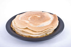 Pancakes. Stack of pancakes on black plate Stock Photos