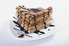 Pancakes. Stack of pancakes with chocolate on white plate Stock Image
