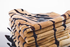 Pancakes. Stack of pancakes with chocolate on white plate Stock Photography