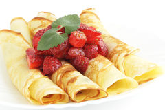 Pancakes. Dessert with the strawberries/the roll pancakes Royalty Free Stock Photo