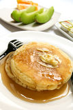 Pancakes. And honey with fresh fruits Royalty Free Stock Photography