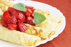 Pancakes. With the fresh strawberries on the plate Royalty Free Stock Image