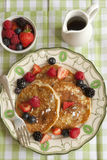 Pancakes. With fresh berries and maple syrup on a plate Royalty Free Stock Image