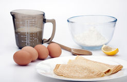 Pancakes. On a white plate with ingredients in the background Royalty Free Stock Image