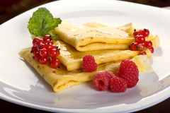Pancakes. With berries and honey Stock Images