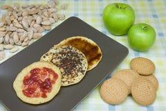 Pancakes. Three home-made pancakes with caramel, chocolate and Strawberry Jam royalty free stock image