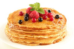 Pancakes. Pancakes with raspberries and honey Royalty Free Stock Images