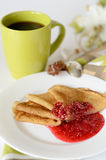 Pancakes. With jam and a cup of coffee for breakfast Stock Image