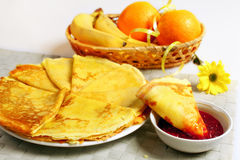 Pancakes. With raspberry jam and fruits stock photo