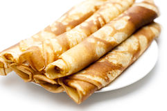 Pancakes. Rolled pancakes on a white plate with white background Royalty Free Stock Photo