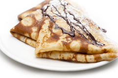 Pancakes. Rolled pancakes on a white plate with white background Stock Images
