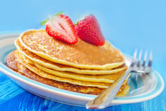Pancakes. With strawberry on plate royalty free stock images