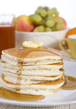 Pancakes. A pile of fresh pancakes with melted butter and syurp Royalty Free Stock Photography