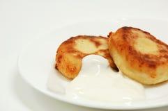 Pancakes. Two pancakes with sour cream Royalty Free Stock Photos