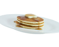 Pancakes. Stack of pancakes with butter and syrup on a plate isolated on white Stock Image