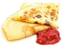 Pancakes. With jamm over the white background Stock Photography