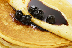 Pancakes. Pile of pancakes with cherry jam Royalty Free Stock Images