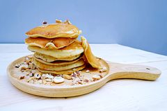 Pancakes with Almonds  in dish. On Table wood Royalty Free Stock Images