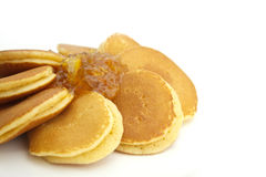 Pancakes. Amd pineapple jam isolated on white background royalty free stock images