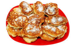Pancakes with apple. Apple pancakes with sugar on red plate Royalty Free Stock Images