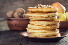 Pancakes. With apple and nuts Royalty Free Stock Photography