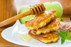 Pancakes with apples and honey Royalty Free Stock Photos